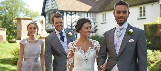 Two Couples in Wedding Attire